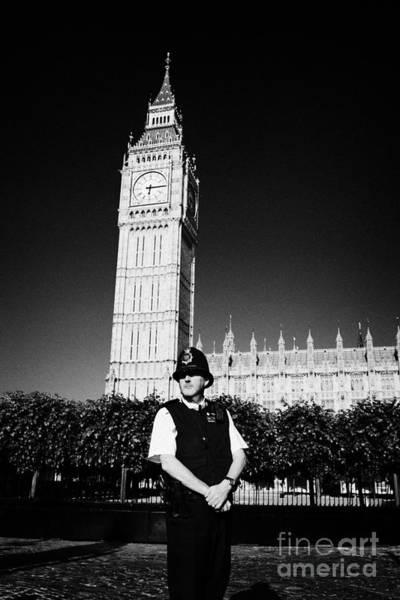 Wall Art - Photograph - british metropolitan police office guarding the houses of parliament London England UK by Joe Fox