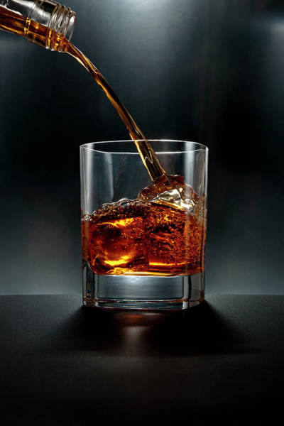 Alcohol Photograph - Brown Liquor Drink Pour On Black by Chris Stein