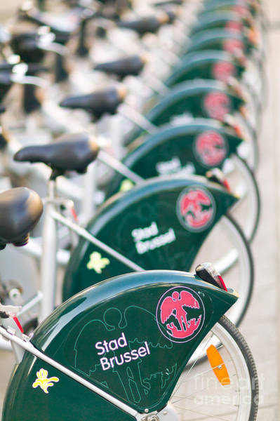 Photograph - Brussels Rental Bikes by Clarence Holmes