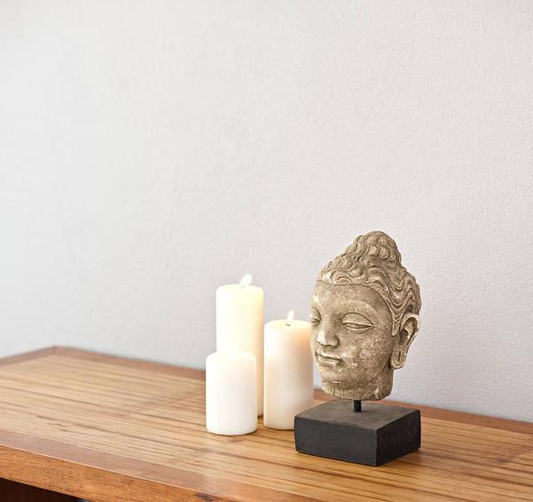 Photograph - Buddha Head With Candles  by U Schade
