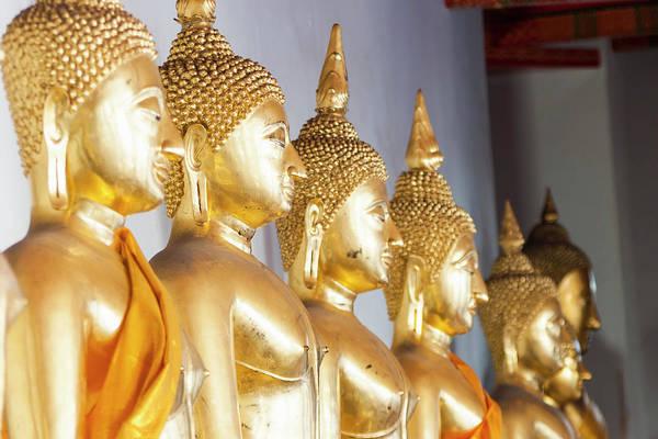 Statue Photograph - Buddha Statues, Wat Pho, Bangkok by John Harper