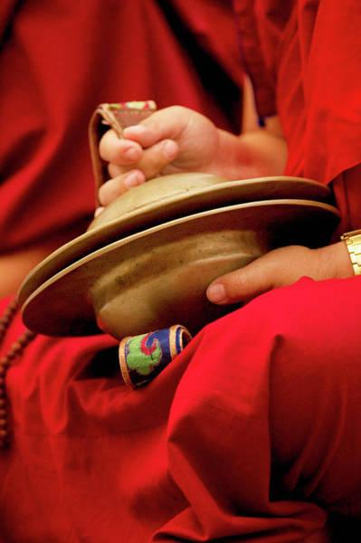 Dalai Lama Wall Art - Photograph - Buddhist Lama Monk With Large Cymbals by Jaina Mishra