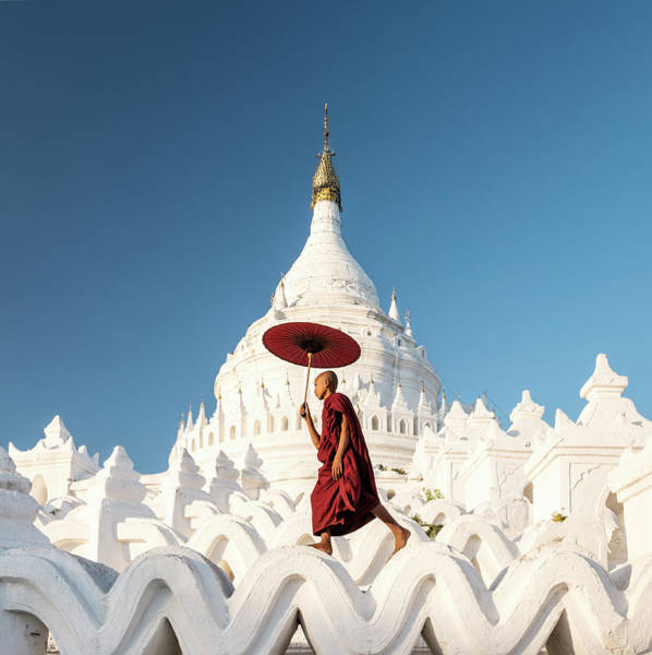 Parasol Photograph - Buddhist Monk Walking Across Arches Of by Martin Puddy