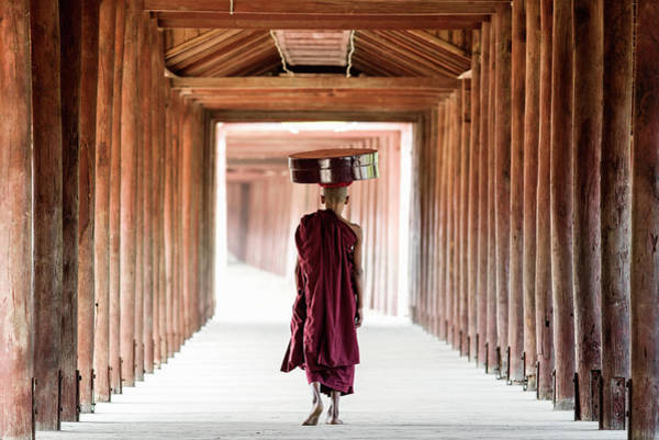 Offering Photograph - Buddhist Monk Walking Along Temple by Martin Puddy