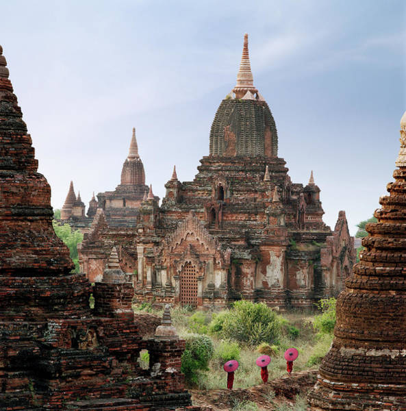 Myanmar Wall Art - Photograph - Buddhist Monks Walking Past Temple by Martin Puddy