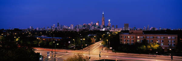 Crossroads Photograph - Buildings Lit Up At Dusk, Chicago by Panoramic Images
