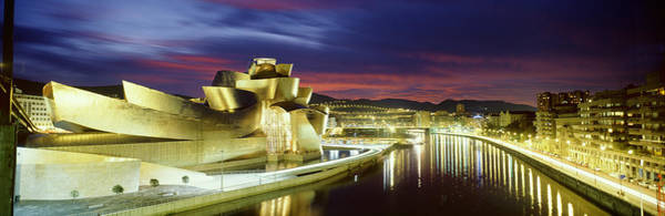 Bilbao Photograph - Buildings Lit Up At Dusk, Guggenheim by Panoramic Images