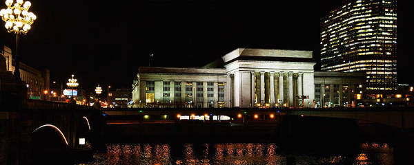 Pennsylvania Station Wall Art - Photograph - Buildings Lit Up At Night At A Railroad by Panoramic Images