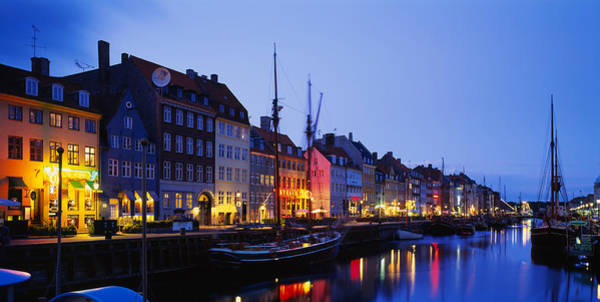 Sidewalk Cafe Photograph - Buildings Lit Up At Night, Nyhavn by Panoramic Images