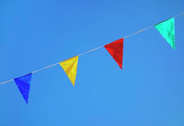 Bunting Photograph - Bunting Against A Blue Sky by Cordelia Molloy