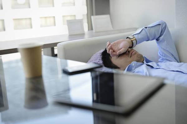 Business Man Sleeping On The Sofa In Office Art Print by Yagi Studio