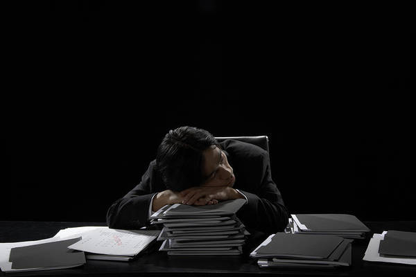 Businessman Asleep At Desk Resting Head On Stack Of Files Art Print by James Woodson