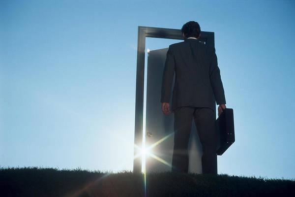 Businessman Entering Door Outdoors Art Print by Comstock