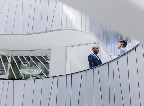 Businessmen Talking On Architectural, Modern Office Balcony Art Print by Caiaimage/Martin Barraud