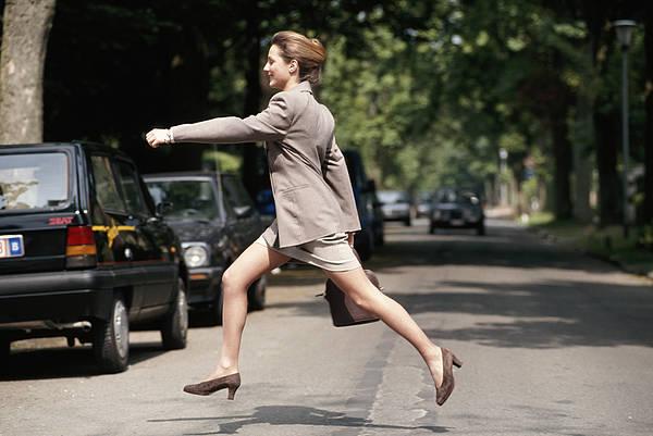 Businesswoman Running Across Road, Side View Art Print by David De Lossy
