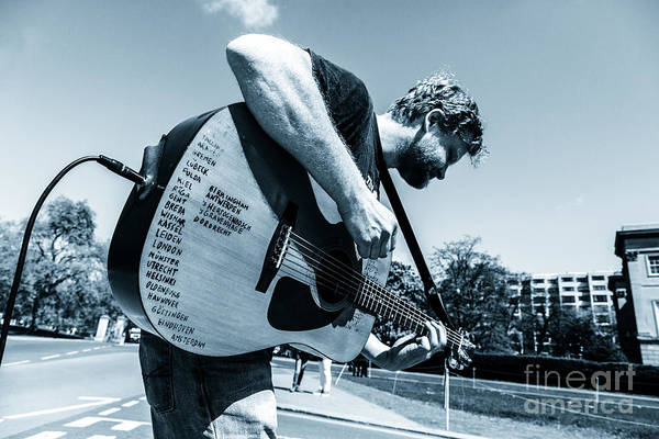 Photograph - Busking Musician With Amplified Acoustic Guitar List Of Places V by Peter Noyce