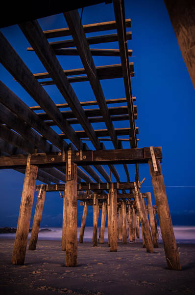 Under The Pier Photograph - Busted Boards by Kristopher Schoenleber