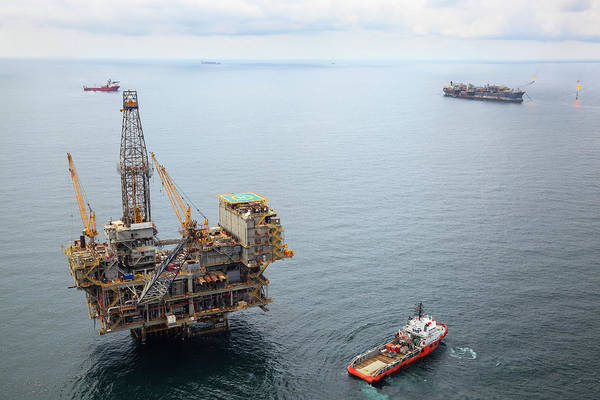 Drilling Rig Photograph - Busy Oil Field by Heliry