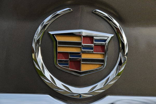 Photograph - Cadillac Emblem Rear Srx by Lawrence Christopher