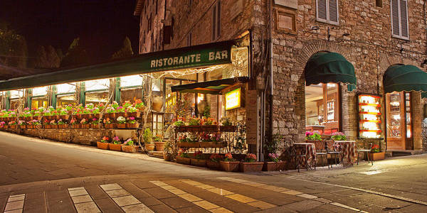 Storefront Photograph - Cafe In Assisi At Night by Susan Schmitz