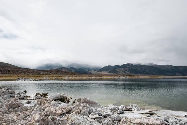 Calm Lake Against Mountain Range Art Print by Christian Soldatke / EyeEm
