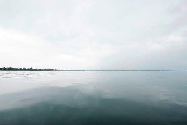 Guatemala Photograph - Calm Water On A River by Leslie Parrott
