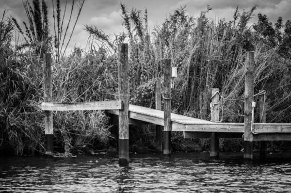 Photograph - Caloosahatchee River Dock - Bw by Carolyn Marshall