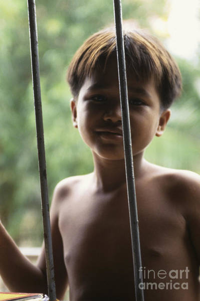 Phnom Penh Photograph - Cambodian Boy At Khmer Rouge Prison Camp by Ryan Fox