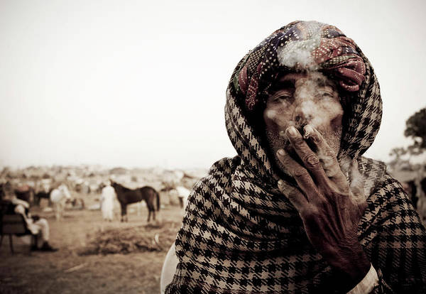 Headwear Photograph - Camel Trader Smoking by April Maciborka