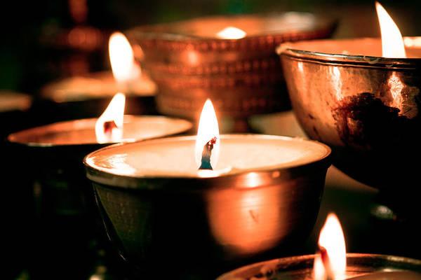 Photograph - candle light ZUTHRUL PHUG MONASTERY Milarepas Cave by Raimond Klavins