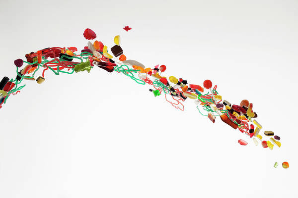 Out Of Focus Wall Art - Photograph - Candy Against A White Background by Dual Dual