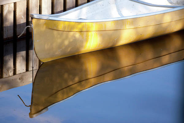 Canoe Photograph - Canoe At Dock On West Hawk Lake by Todd Lawson