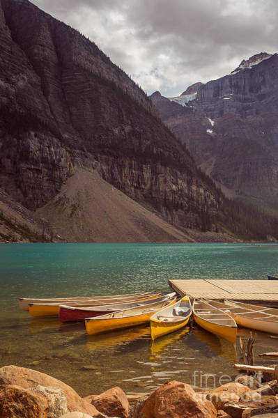 Canmore Photograph - Canoe For Rent In Banff's Moraine Lake by Edward Fielding