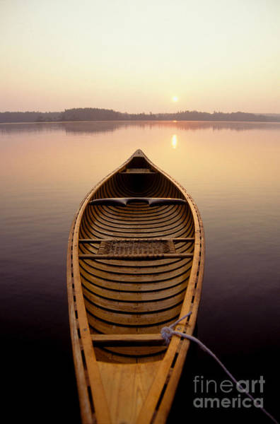 Photograph - Canoe On A Lake by Novastock