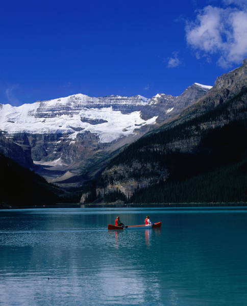 Canoe Photograph - Canoeing Lake Louise In The Canadian by Jan Stromme