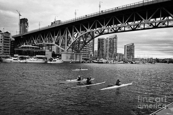 Canoeist Wall Art - Photograph - canoeists canoeing along false creek underneath the granville bridge Vancouver BC Canada by Joe Fox