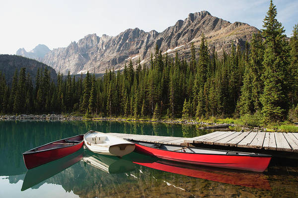 Rowboat Photograph - Canoes And Rowboat By A Dock On A by Michael Interisano / Design Pics