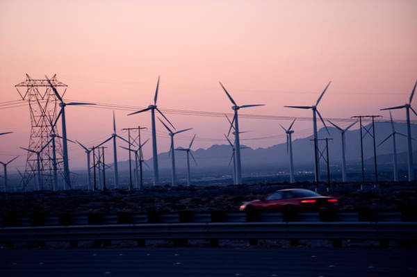 Riverside California Photograph - Car Moving On A Road With Wind Turbines by Panoramic Images