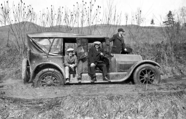 Urban Expressions Wall Art - Photograph - Car Stuck In Mud by Underwood Archives