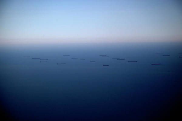 Freight Transport Wall Art - Photograph - Cargo Ships Out At Sea by Tobias Titz