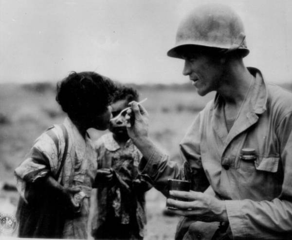 Sentimentality Photograph - Caring Solider by Retro Images Archive