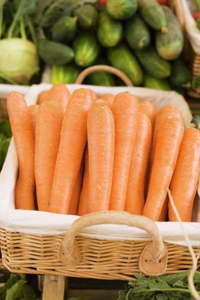 Wall Art - Photograph - Carrots In A Basket At A Market by Foodcollection