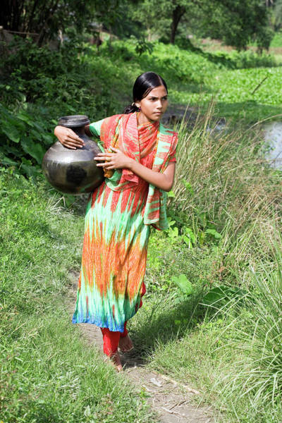 Fetch Photograph - Carrying Water by Adam Hart-davis/science Photo Library
