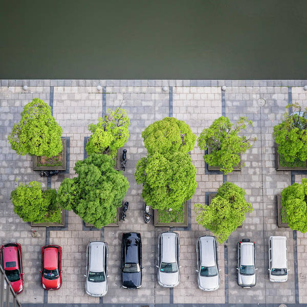 Parking Photograph - Cars On A Parking Lot by Chinaface