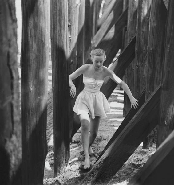 Coastline Photograph - Catherine Murray Walking Through Wooden Pylons by Frances McLaughlin-Gill
