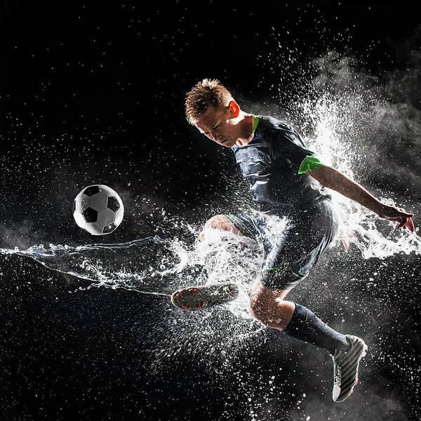 Practice Photograph - Caucasian Soccer Player Splashing In by Erik Isakson