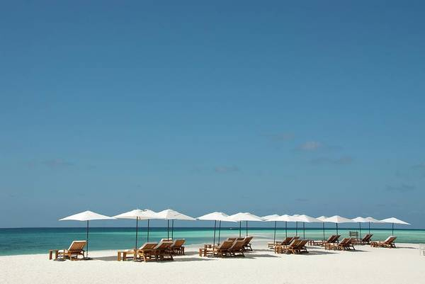 Atoll Photograph - Chairs And Umbrellas On The Beach by Scubazoo