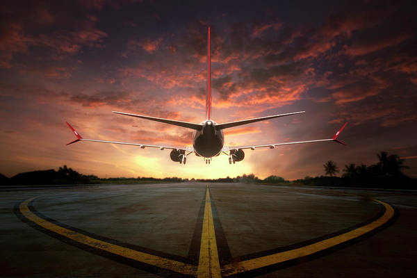 Aviation Photograph - Chasing The Sunset by Ganjar Rahayu