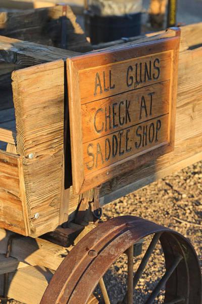Photograph - Check Guns At Saddle Shop by Michael Hope