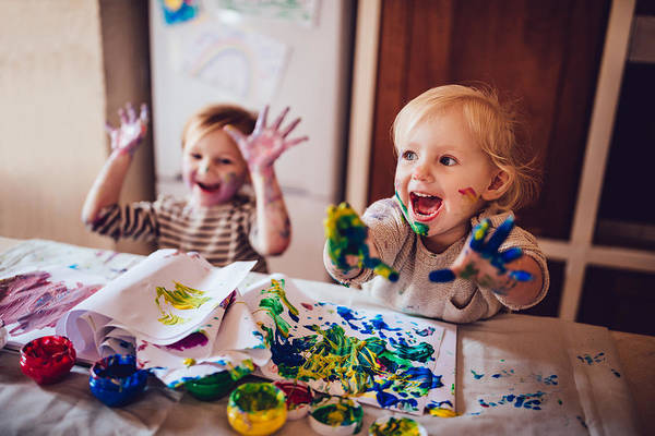 Cheerful Little Children Having Fun Doing Finger Painting Art Print by Wundervisuals
